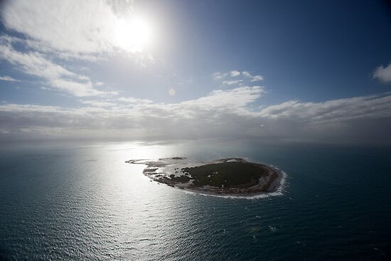 Aerial view of Snapper Island, Queensland, Australia with white cloud formations and blue ocean by Sharpeyeimages