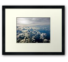 Aerial view of white cloud formations and blue ocean Framed Print
