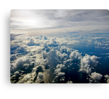 Aerial view of white cloud formations and blue ocean Canvas Print