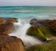 Ocean view and rocks using slow shutter speed by Sharpeyeimages