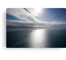 Aerial view of sea near Queensland, Australia with white cloud formations and blue ocean Canvas Print