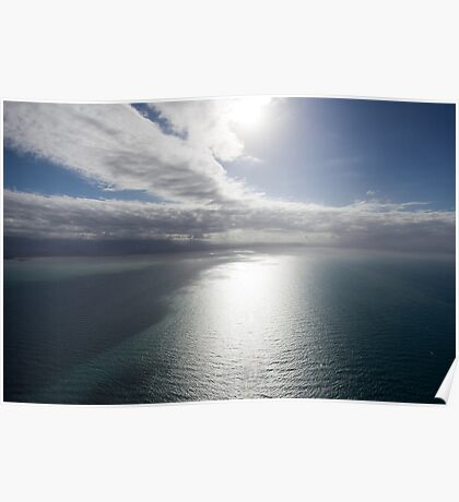 Aerial view of sea near Queensland, Australia with white cloud formations and blue ocean Poster