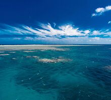 White cloud formations and blue ocean with reef, Australia by Sharpeyeimages