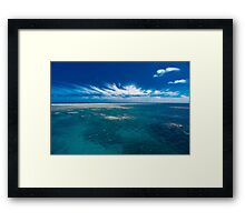 White cloud formations and blue ocean with reef, Australia Framed Print