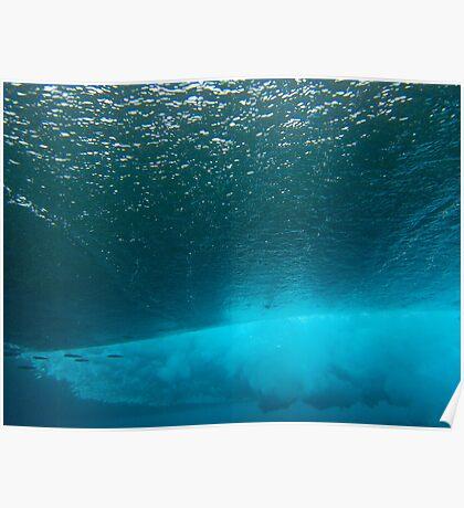 Underwater view of breaking wave in blue ocean Poster