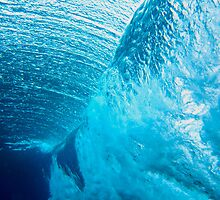 Underwater view of breaking wave in blue ocean by Sharpeyeimages