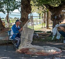 Mending nets, San Feliciano, Lago Trasimeno, Umbria by Andrew Jones