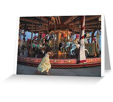 Girl plays with carousel Greeting Card