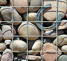 Rock wall with horseshoe by Jeff Knapp