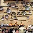 Pottery display in a Persian market by Jeff Knapp