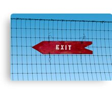 Wooden arrow sign on fence with word 'Exit' Canvas Print