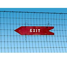 Wooden arrow sign on fence with word 'Exit' Photographic Print