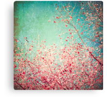 Pink autumn leafs on blue textured background Canvas Print