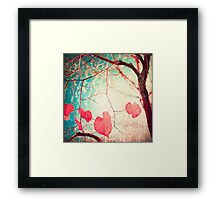 Pink autumn leafs on blue textured background Framed Print