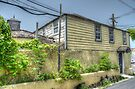 Old house at the corner of West Hill Street and Blue Hill Road in Nassau, The Bahamas by 242Digital