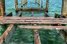 Pier at Montagu Beach in Nassau, The Bahamas by 242Digital