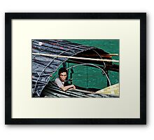 fisherman and his mobile phone Framed Print