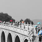 Umbrellas in Beijing 17 arch bridge by SteveHphotos