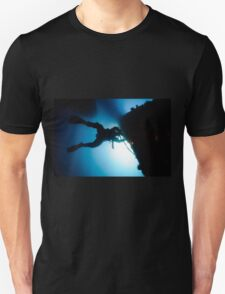 underwater Commercial diver welding pipes underwater. Unisex T-Shirt