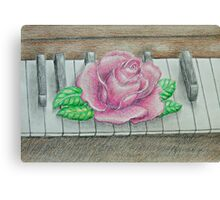 pink rose on piano Canvas Print