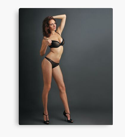 A young redhead woman posing sexy in transparent lingerie Canvas Print