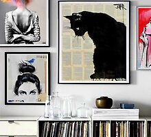 prints on a wall by Loui  Jover