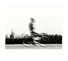 Motion blur of a bicycle rider in black and white  Art Print