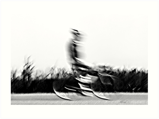 Motion blur of a bicycle rider in black and white  by PhotoStock-Isra
