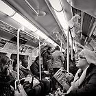 Riding the Tube - London - Britain by Norman Repacholi