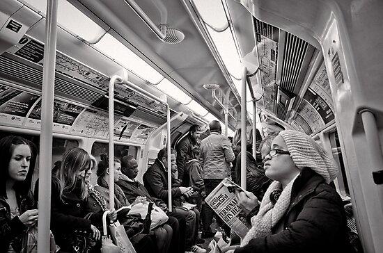 Riding the Tube - London - Britain by Norman Repacholi