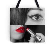 Teen girl applying make up Tote Bag