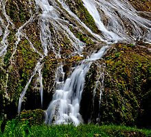 Flowing waterfall taken with slow shutter speed for calming effect by Sharpeyeimages
