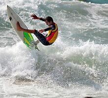 Surfer spins on the crest of a wave by PhotoStock-Isra