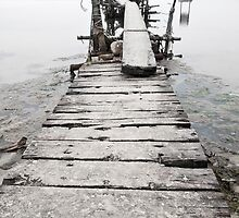 Desolated wooden pier in low saturation by kawing921