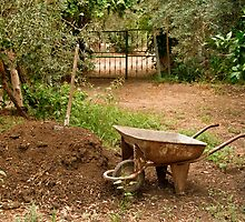 Wheel Barrow Next To Soil Heap by Kuzeytac