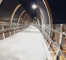 Futuristic metal pedestrian bridge over road, Sydney, Australia by Sharpeyeimages