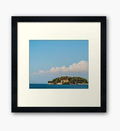 Blue skies over the sea Framed Print