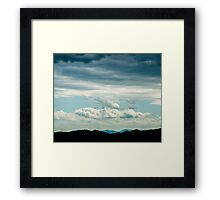Black vs. blue Framed Print