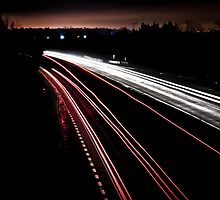 Motorway Light trails by Michael Hollinshead