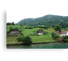 Houses on a mountain slope near Lake Lucerne Canvas Print