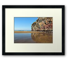 cliff face with icicles and reflection Framed Print