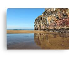 cliff face with icicles and reflection Canvas Print