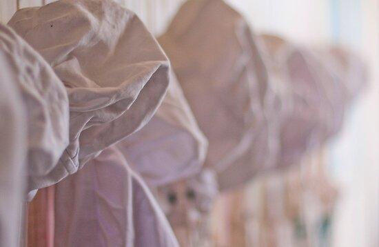 Hats in a Row  by Lorraine Creagh
