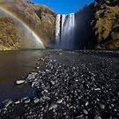 Rainbow by a waterfall by Sven Brogren