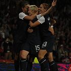 Megan Rapinoe celebrates scoring v Canada by Matt Eagles