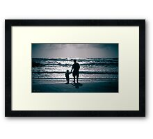Father and Son on the beach at dusk Framed Print