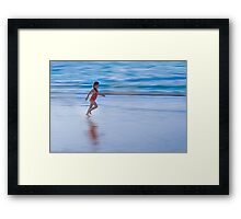 Girl running on the beach Framed Print