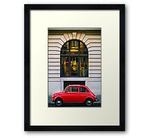 Red Car in front of an arc Framed Print