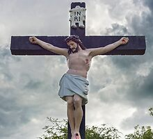 large crucifix in a graveyard by morrbyte