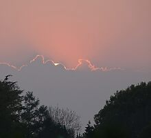 Sunset and clouds by Sue Robinson